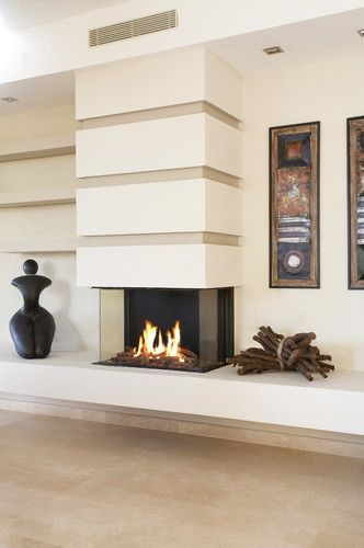It looks like horizontal detail on the fireplace face transitions into built-in shelving on the adjacent wall. Note the cantilevered bench - great detailing.....