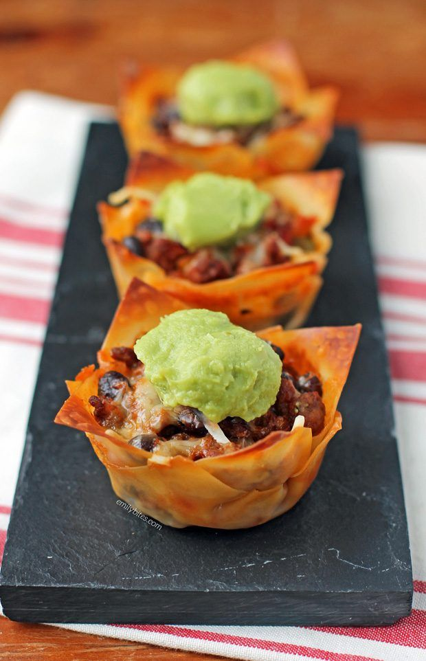 These Taco Wonton Cupcakes are full of seasoned meat, cheesy queso dip, hearty beans and juicy salsa! Just 148 calories or 4 Weight Watchers SmartPoints. www.emilybites.com
