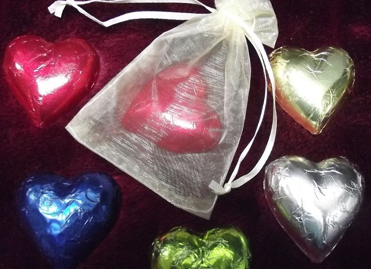 LARGE FOIL CHOCOLATE HEART IN ORGANZA BAG (DARK OR WHITE CHOCOLATE)  Large chocolate heart foil wrapped in organza bag - colour of your choice. $1.80 each