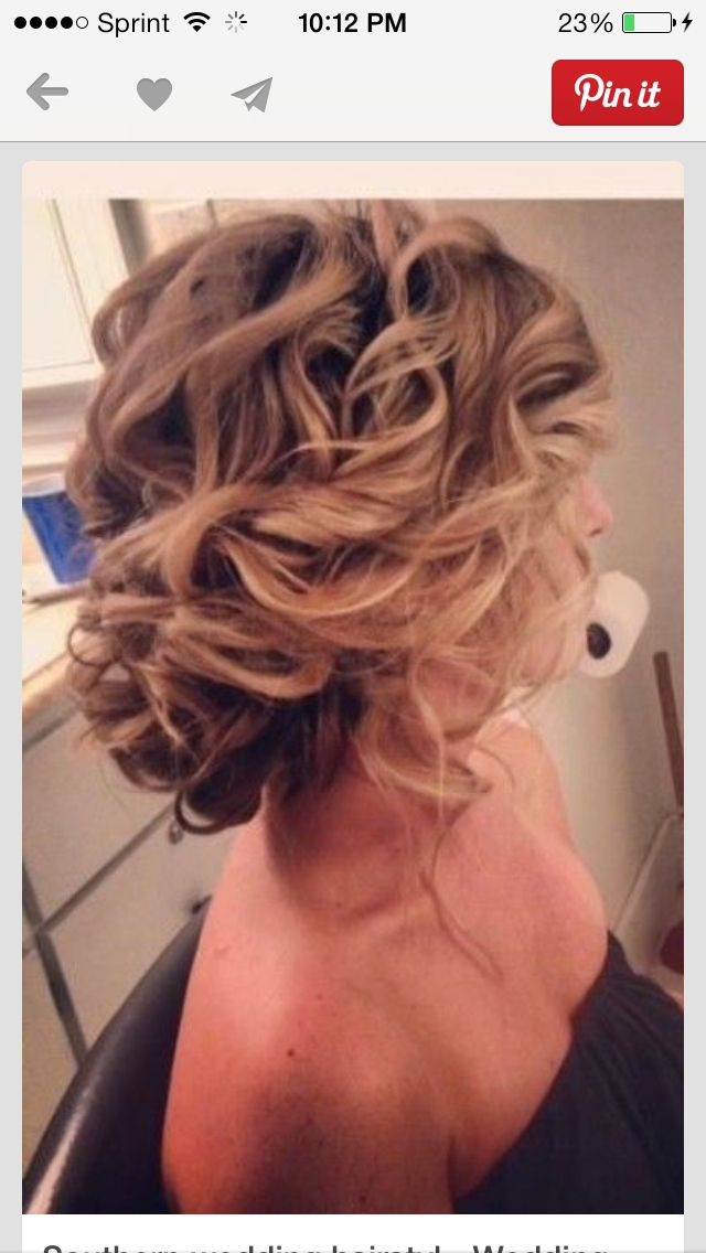 If I decided to have an up-do for wedding day I think I would like something like this. Cute, messy, and curly, but still nice for wedding. -mfournier