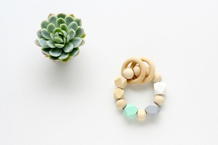 Silicone & Wooden Teething Toy  Silicone Teether, Baby Teething Ring Wood and Mint silicone beads  The ever-changing shapes and edges appeals to tiny hands and make it fun for your little to follow.