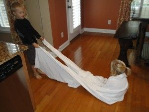 Blanket Pulls are a great activity to provide proprioceptive input which is calming and can organize a child' brain.