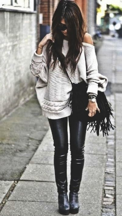 Street fashion leather skinnies and oversize chunk sweater