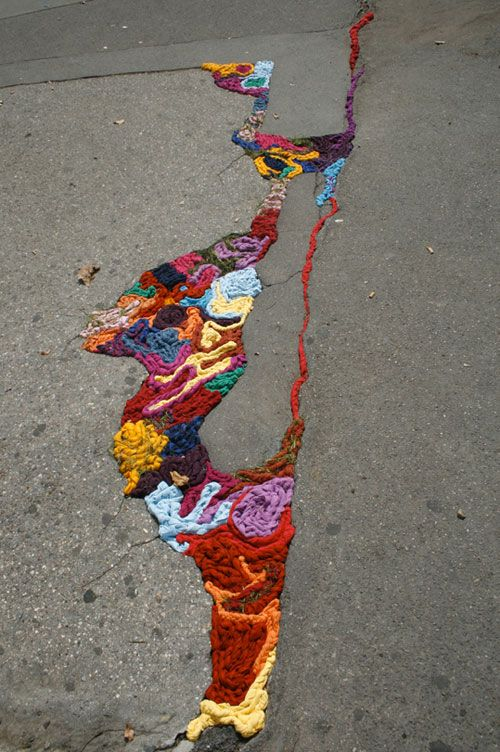 If only all our street cracks were filled like this!  Juliana Santacruz Herrera's Knitted Street Art