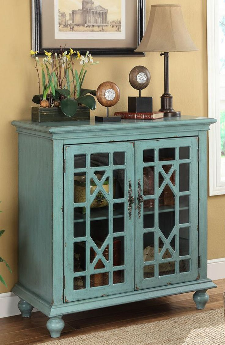 The detailed pop of color & storage space make this home accent a must have for your home!