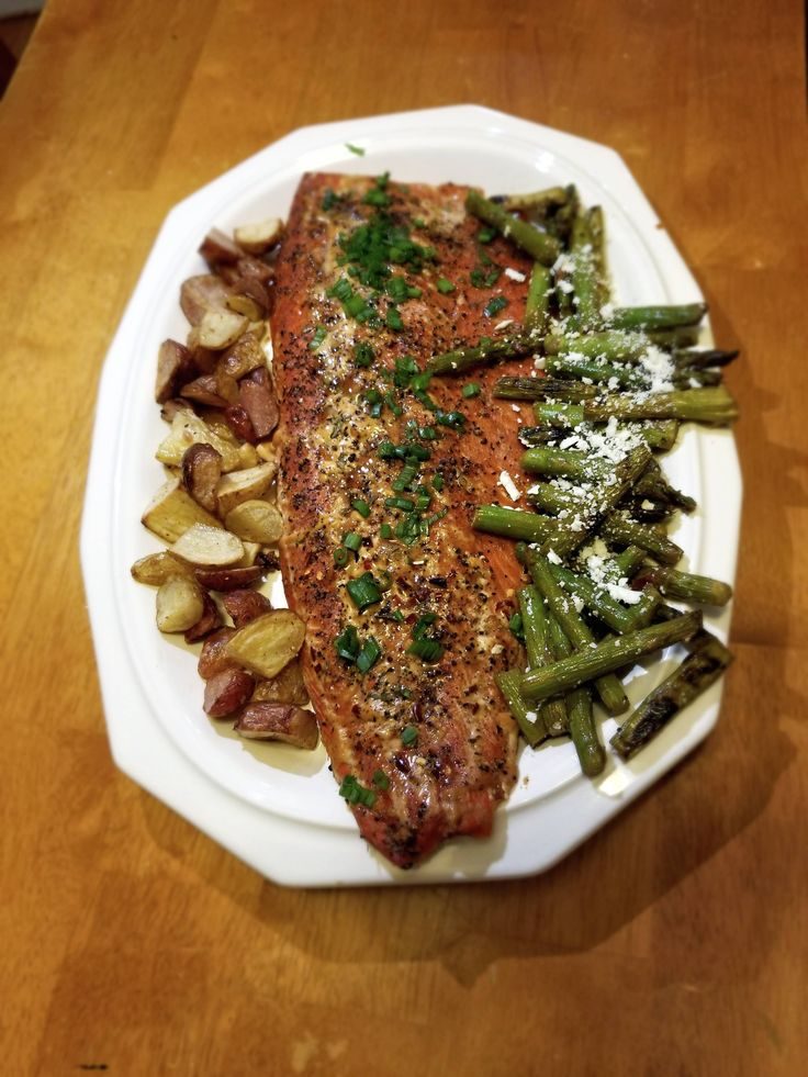 Brown sugar glazed salmon crispy potatoes and grilled asparagus with bacon & cotija cheese