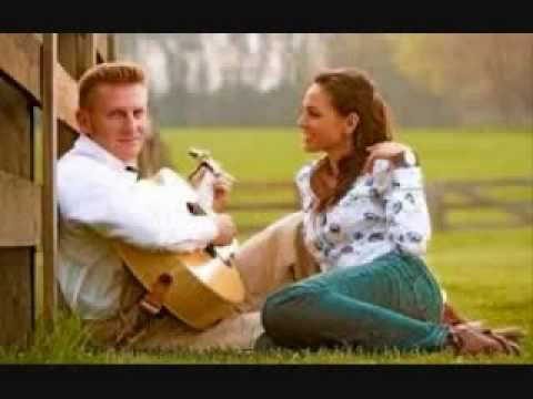 """If Not For You"" - Joey + Rory...If not for you I would know nothing of  This balcony, this panorama love.  The world would seem a dreary thing  Four walls without a window  A room without a view  If not for you"