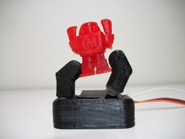 This is a robotic gripper from one of my instructables: http://www.instructables.com/id/Single-Servo-Robotic-Gripper/
