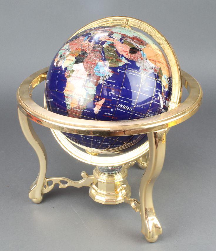 "Lot 215, A Franklin Mint polished ""hardstone"" terrestrial globe raised on a gilt metal stand est £40-60"