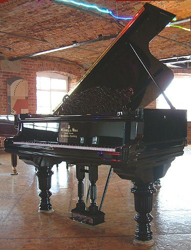 Steinway Grand Piano Detailed Legs | Steinway Model C grand piano with a french polished, black case.