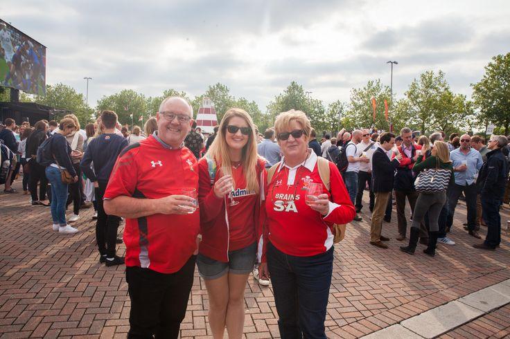 Enjoying the sunshine and the action on screen at Twickenham stadium