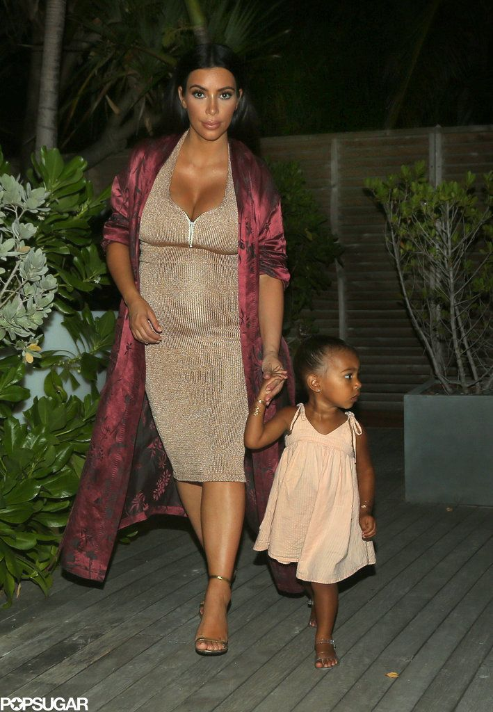 Kim Kardashian and North West Are Total Beach Babes in St. Barts: Kim Kardashian bared her baby bump in a bronze bikini during her recent vacation in the Caribbean.
