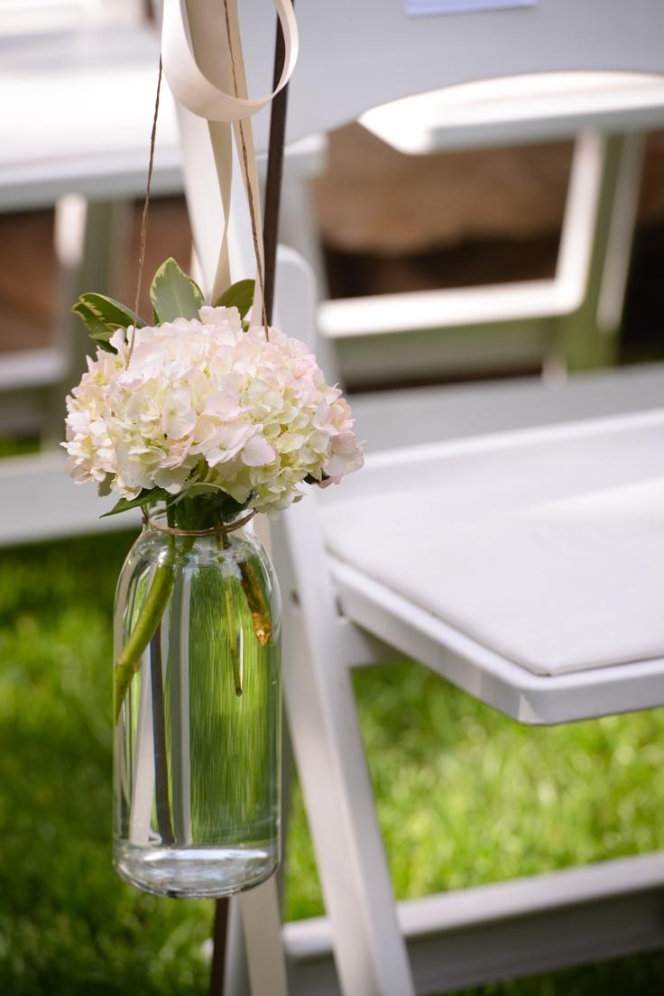 Shepherds hook hanging flowers wedding isle decor