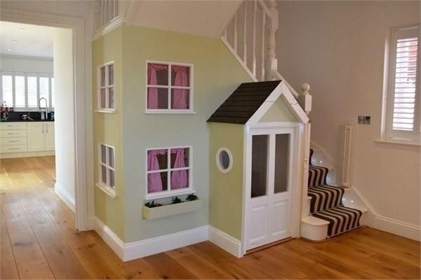 under the stairs play house.....genius!