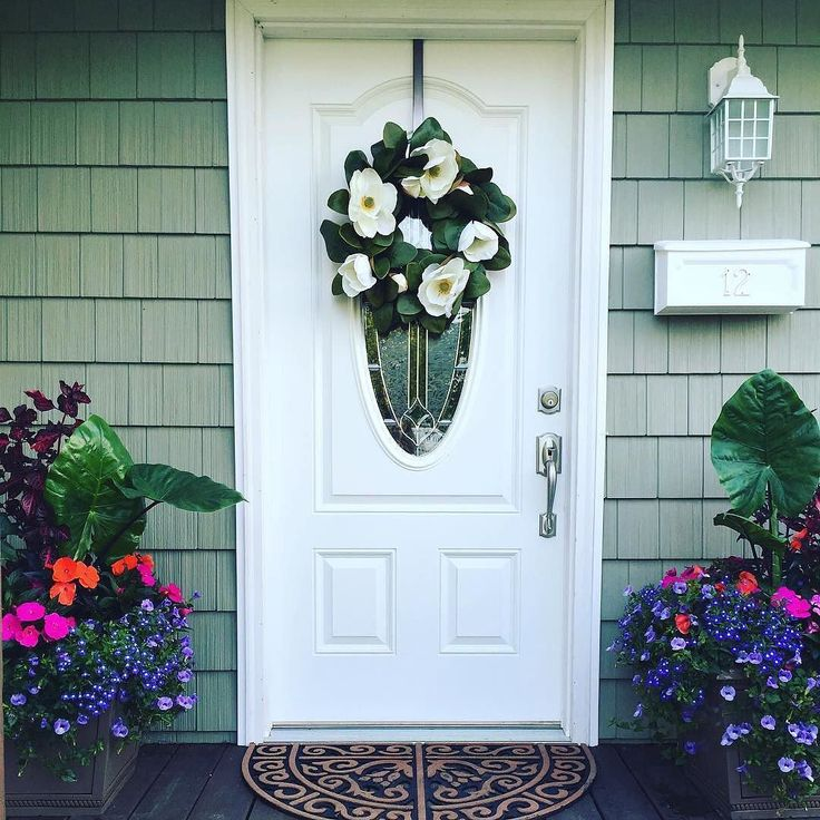 We love how @catgretschel used fresh pops of color to create this inviting entryway. How do you make visitors feel welcome? Show us with #pier1love.  A #pier1 Faux #Magnolia Wreath keeps the welcome going all year long. Find it via our Like2b.uy/Pier1 link in our Instagram profile.