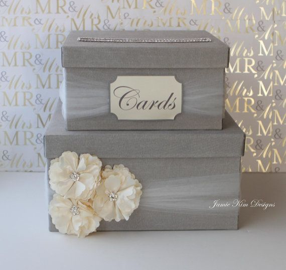 【 MODEL: SARAH (N)】 This wedding card box is beautifully made with silk shantung, tulle, satin flower and rhinestones. Rhinestones around the card slot give the box a more luxurious look. ♦♦ Note: Listing price includes Cards sign ♦♦ ♦ COLOR The box and tulle come in colors of your choice. The satin flower come in either colors: white, ivory, champange gold, soft pink, yellow, fuschia, red, turquoise, lavender, coral, light blue, peach, eggplant, dark grey, black, blue or sage. ♦ SIZE 12...