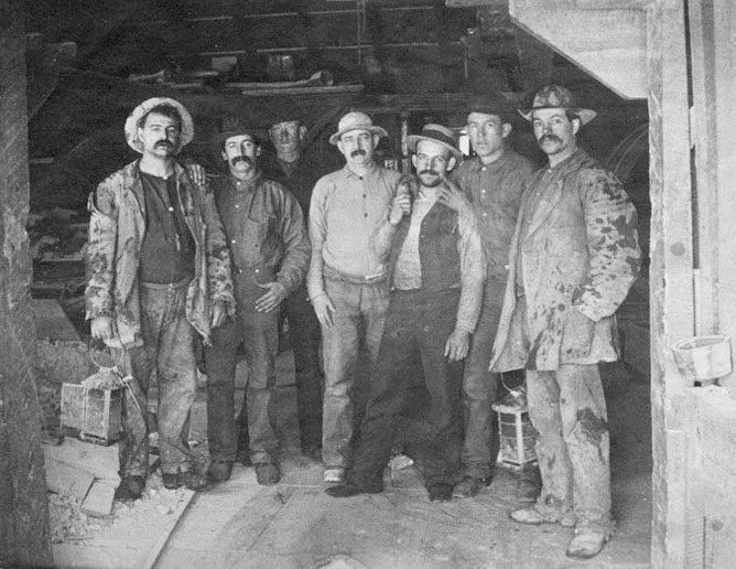 """""""Seven Comstock Miners"""" photograph, searching for silver in Nevada, 1880s. Taken by Frances S. Osgood and captioned """"To Labor is to Pray""""."""