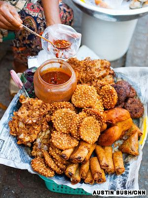 Deep-fried snacks are widely available on the streets of Yangon.