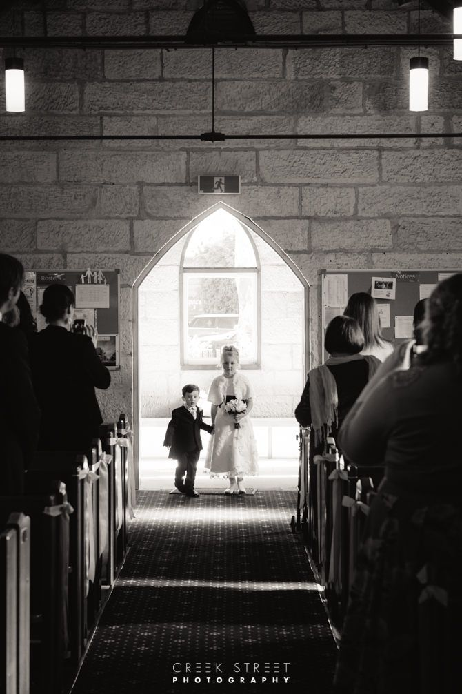 Flower girl and page boy walking into church St John's Anglican Church Mona Vale #kidsatweddings #kids #children