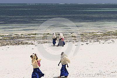 People Walking On Tropical Beach In Kiwenga Village Zanzibar Island Tanzania Africa