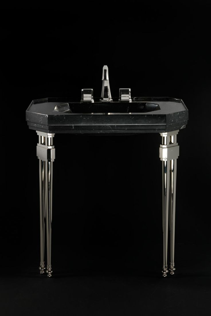 Michelangelo  Cubicle and sanitary fittings in Black Moon marble. Precious in choice of materials and in conception, Michelangelo is a unique line  including a cubicle and sanitary fittings made entirely in Black Moon.