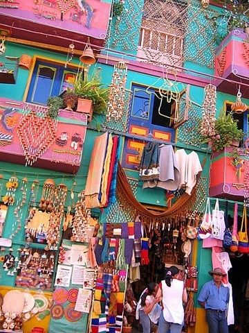Colorful shops in Raquira, Colombia...visit the Sunday market to shop for hand made pottery and woven goods.