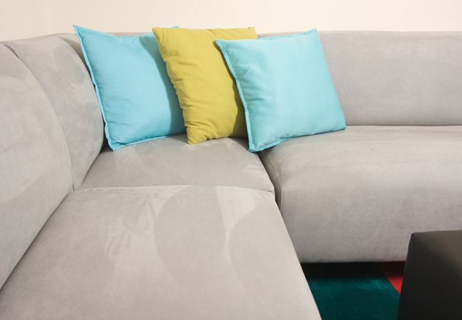 Suede couches can be particularly tricky to clean. First, check what label is associated with the fabric, then use a DIY cleaner of either water and mild dish soap, or rubbing alcohol to restore your sofa to like-new status. See here for the full details.
