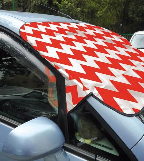 Don't let Jack Frost delay your commute. This handy winter windshield cover keeps the frost out so you can hop in your car and go, even on the frostiest of mornings. It features a cool red and white geometric pattern.