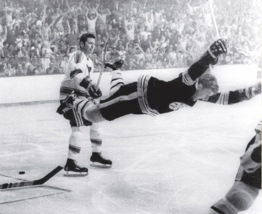 Bobby Orr scores winning goal while airborne during 1970 Stanley Cup overtime win as Bruins sweep St Louis Blues. Awesome photo