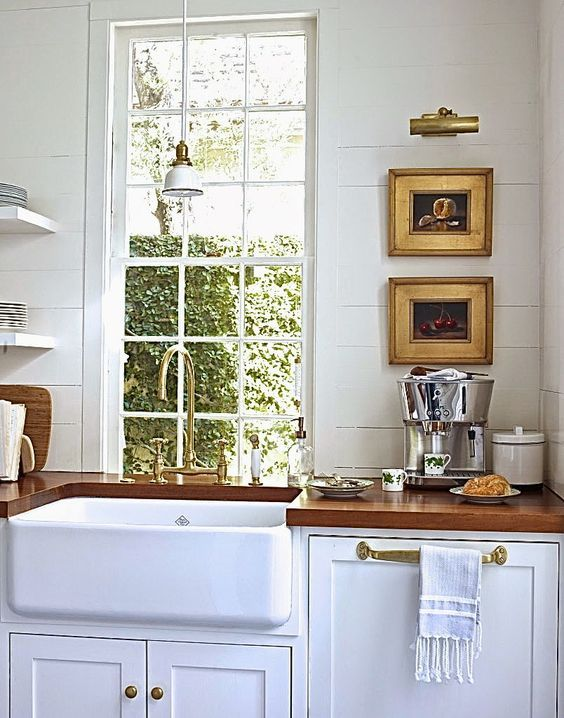 cute kitchen design love the deep sink and the little picture gallery. Interior Design Ideas. Home Design Ideas