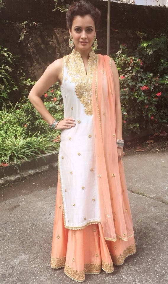 Dia Mirza in white embroidery work sleeveless high neck kurti contrast peach color embroidery work palazzo pant