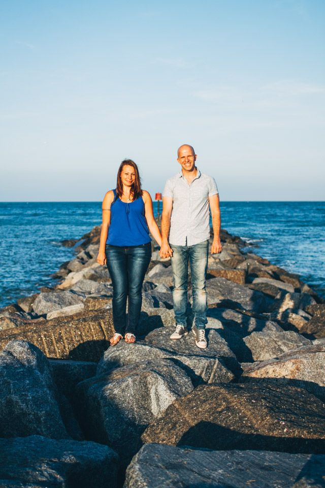 Couple stand strong holding hands on the sea rocks #engagement #prewedding #couple #ocean #sea #rocks #beach #coastal
