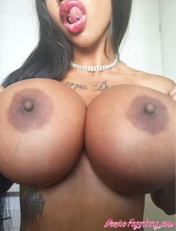 Busty ebony chick playing with her pussy in front of webcam