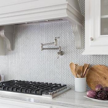 White and Gray Herringbone Backsplash Tiles by Ann Sacks