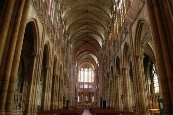 St. Denis Cathedral, Paris. Often overlooked but has beautiful stained glass windows. Most of France's kings entombed here.