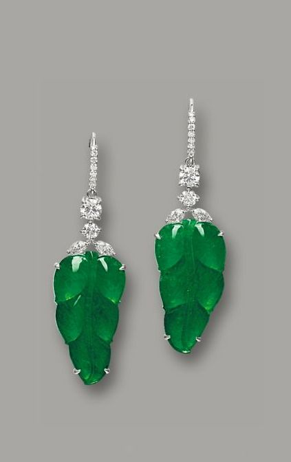 JADEITE 'LEAF' AND DIAMOND PENDENT EARRINGS Each suspending a leaf of highly translucent emerald green colour, surmounted in diamonds, mounted in white gold. | Sotheby's