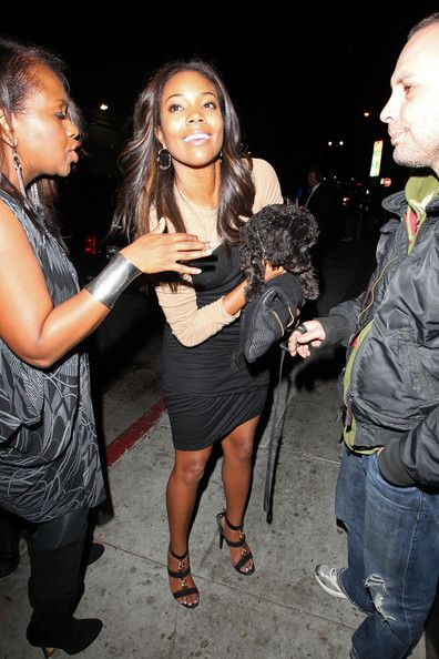 Gabrielle Union Photos Photos - Actress Gabrielle Union chats to a fuzzy black pooch outside Eden nightclub in Hollywood. - Gabrielle Union at Eden Nightclub in Hollywood