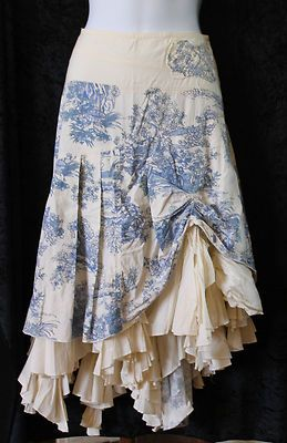 Add ruffled layers to the underneath of a pretty skirt and then pull and stitch bits of the skirt up to expose the ruffles.