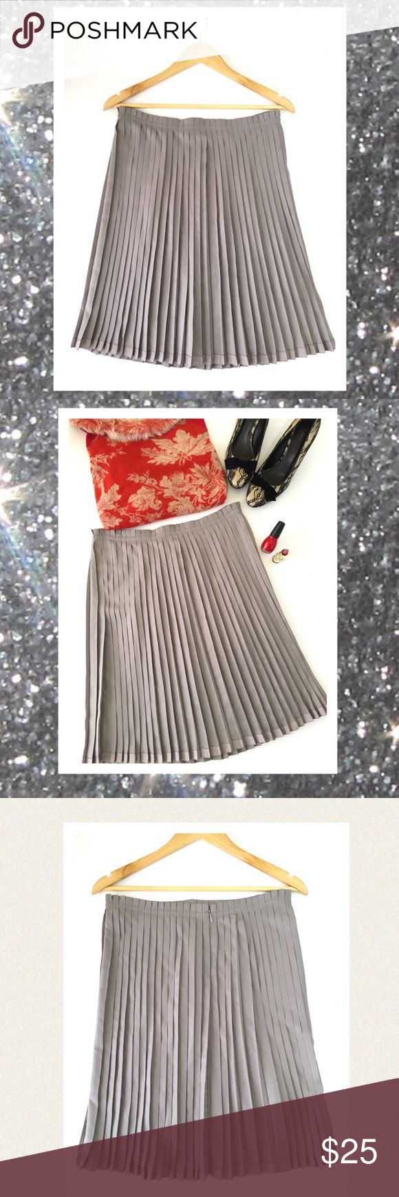 """🆕 GAP pewter grey pleated skirt. Adorable sassy little pleated skirt will look fabulous with tall boots or heels. A perfect and versatile holiday skirt! Zips in the back. Worn once. Perfect condition. Appx measurements: 🔹Waist 34"""" 🔹Length 21"""" 🔹Hip area 34"""" GAP Skirts"""