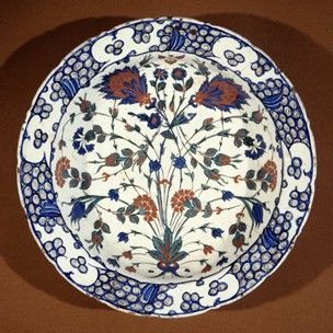 Iznik Dish, 16th century. Composite lotus medallions, broken stems of roses, cornflowers, tulips, campanulas, cloud clips, wave and rock scroll. Made of black, cobalt, blue-green, red (bole) painted and glazed ceramic, pottery.