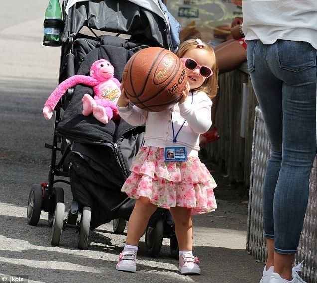 Tiny ballerina: The toddler looked adorable in a white cardigan and frilly pink tutu skirt, proving herself to be the envy of the playground with a pair of cute sunglasses