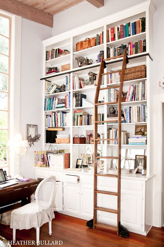 tall bookshelves with a ladder. i've wanted this in my house ever since i saw Beauty and the Beast as a child.