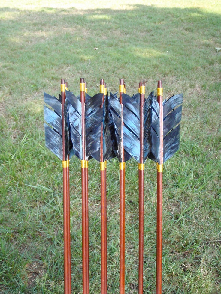 Katniss Arrows, 30-35lb, Hunger Games inspired archery arrows, traditional wood archery arrow set. $100.00, via Etsy.