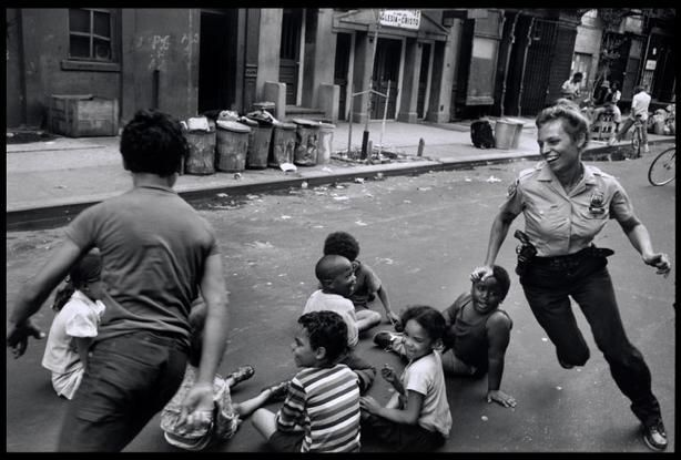 usa 1978 new york city a police woman plays with local kids in harlem by leonard freed