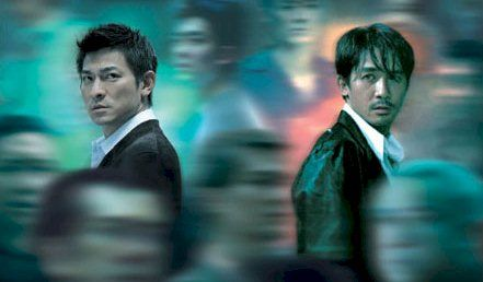 Infernal Affairs.  Feel free to completely ignore The Departed (which is twaddle, over-balanced into ludicrousy by Jack Nicolson), in favour of the orginal, superior, Infernal Affairs.