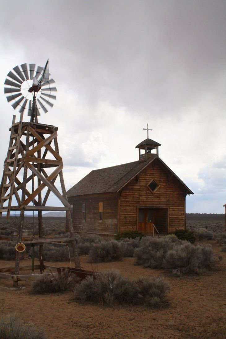 Fort Rock, Oregon church and windmill.