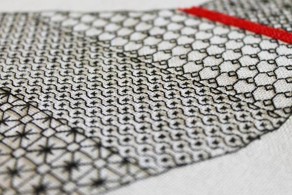 Black work embroidery on white aida