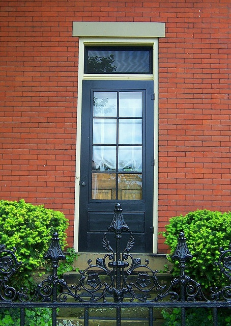 black door red brick, creamy white trim - possible new colour scheme for house
