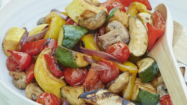 Zucchini, red and yellow peppers, mushrooms, yellow squash, and cherry tomatoes are marinated in a lemon-soy marinade and grilled.