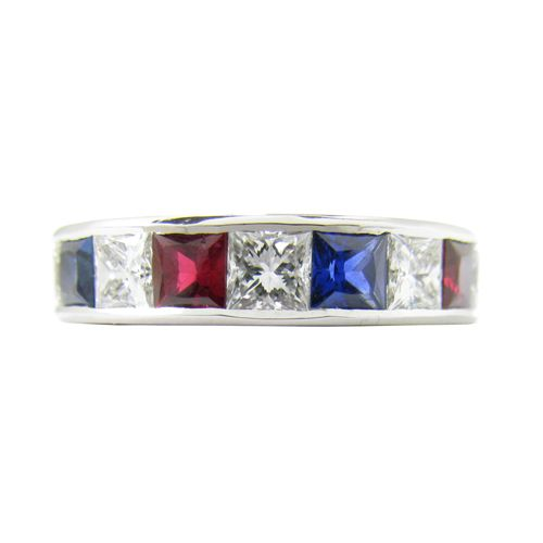 DIAMOND, RUBY, SAPPHIRE RING  Set in a Platinum channel setting are princess cut Diamonds, Rubies and Sapphires. This is a full eternity gemstone ring.